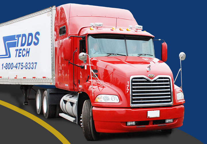 TDDS red truck drives in.